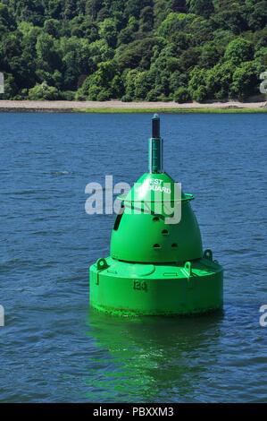 Green marker buoy near Devil's Point, Plymouth Sound, Devon, England, UK - Stock Photo