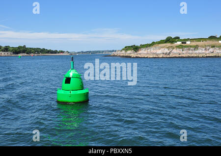 Green marker buoy near Devil's Point at entrance to River Tamar, Plymouth Sound, Devon, England, UK - Stock Photo