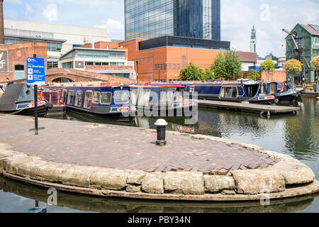 Moored narrowboats at Regency Wharf, Gas Street Basin, Birmingham, England, UK, where the Worcester and Birmingham Canal, and the BCN Main Line meet. - Stock Photo