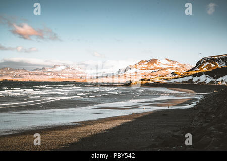 Snaefellsnes Weste Iceland Ocean view with beach and mountains and blue sky in the background. - Stock Photo