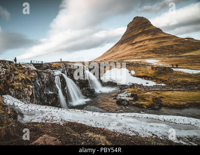 Kirkjufellsfoss and Kirkjufell Icelandic, Church mountain , a 463 m high mountain on the north coast of Iceland's Snaefellsnes peninsula, near the town of Grundarfjordur, Iceland - Stock Photo
