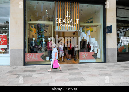 Shopper walking past the Seasalt Cornwall clothing store in Cardiff City Centre Wales UK    KATHY DEWITT - Stock Photo