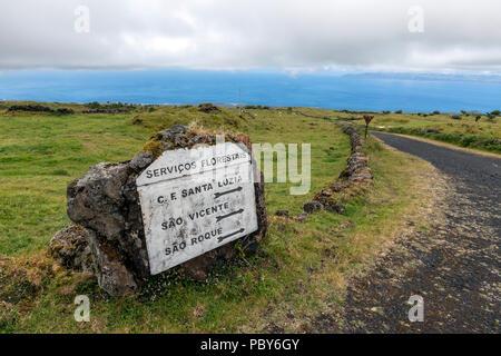 Servicos Forestais, direction sign to Sao Vicente, Sao Roque and Santa Luzia in EN3 road, Pico island, Azores, Portugal - Stock Photo