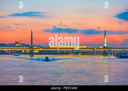 The Golden Horn Metro Bridge in Istanbul at sundown, Turkey - Stock Photo