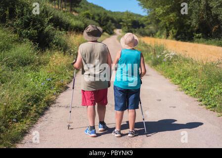 Senior couple on hike - Stock Photo