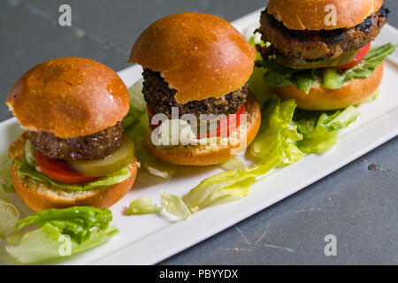 Close up shot of 3 sliders on a plate - Stock Photo