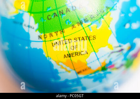 Child's globe showing United States of America or US, USA, concept - Stock Photo