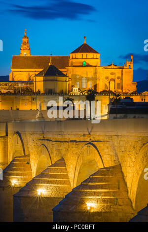Andalucia Spain Moorish, view at night across the Roman bridge (Puente Romano) towards the Cathedral Mosque (La Mezquita) in Cordoba, Andalucia,Spain. - Stock Photo