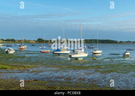 Small boats at low tide, Dell Quay, Chichester Harbour, UK. - Stock Photo