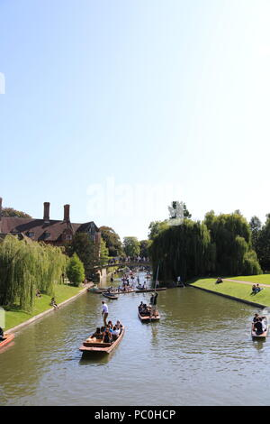 People punting on the river Cam in Cambridge - Stock Photo