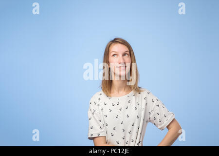 Young european woman thinking and looking up, confused about an ide - Stock Photo