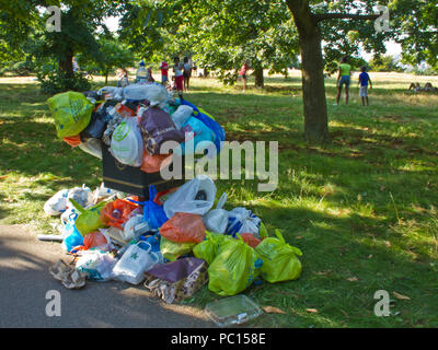 Litter Bin overflowing with Bags rubbish - Stock Photo
