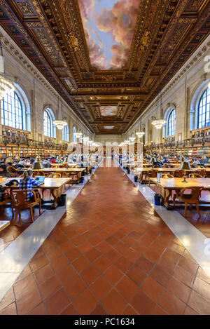 NEW YORK CITY - December 12: people study in the New York Public Library on December 12, 2017 in Manhattan, New York City. Rose Main Reading Room wide - Stock Photo