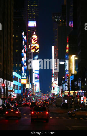NEW YORK, NY - JULY 11: Broadway Theater District and Times Square neon lights seen south from 7th Avenue in Manhattan on evening JULY 11th, 2017 in N - Stock Photo