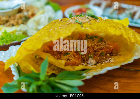 Vietnamese Savory Crepe on plate - Stock Photo