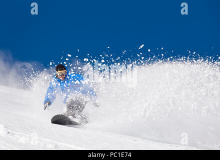 Peter Spain  enjoys untracked snow and clear blue skies on the Davis Creek park run off of Mt. Rose Ski Tahoe. - Stock Photo