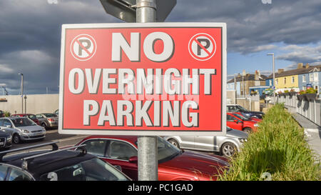Sign at a car park warning people not to park overnight. - Stock Photo
