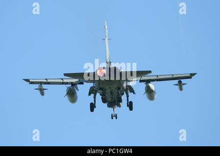 RAF Tornado GR4 passing directly overhead into RAF Marham. The pilot has put one engine into afterburner/reheat for the overshoot. - Stock Photo