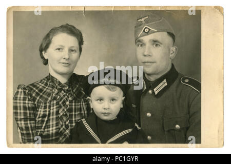 German historical family photo: Husband in uniform and wife and son in Navy cabin boy clothes. Torn edges, 1941, world war two, Germany, Third Reich - Stock Photo