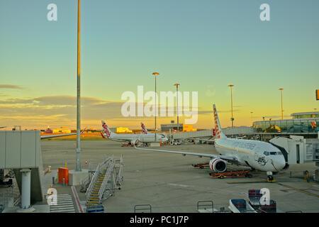 Brisbane, Queensland, Australia - June 23, 2018: Virgin Airlines Terminal, planes getting loaded and unloaded. - Stock Photo