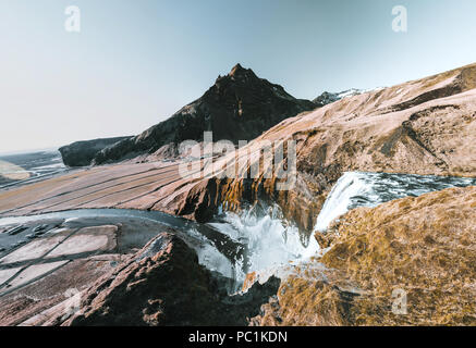 Iceland Fantastic views of the landscape with river and mountain with blue sky on a sunny day. - Stock Photo