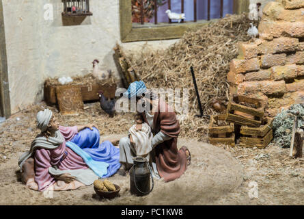 Badajoz, Spain - December 2017: Christmas Nativity scene. Holy Family resting after Birth of Jesus. By Local Ac of Cribs of Badajoz - Stock Photo