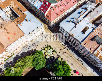 aerial view of city streets. tourists walking. cafe outside - Stock Photo