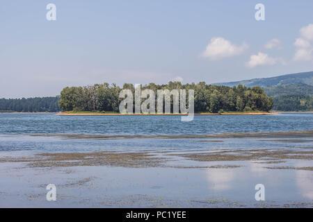 Stratorija island in the Vlasina Lake in Serbia - Stock Photo