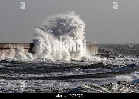 Big stormy waves against Leixoes harbor north wall, Leca da Palmeira, Portugal - Stock Photo