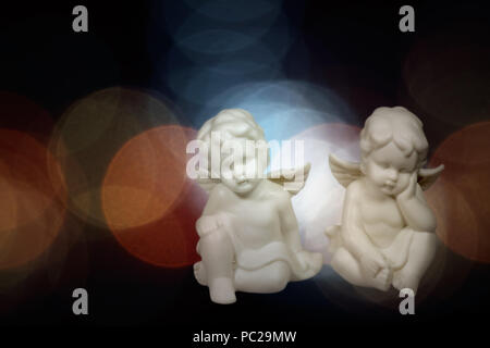 Soft christmas angels against flare background. Used digital filters. - Stock Photo