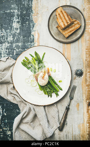 Healthy breakfast with green asparagus, soft-boiled egg , bacon and toasts - Stock Photo
