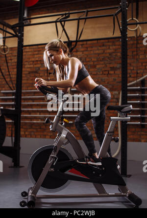 sportswoman is doing cario exercise in the moder gym. full length photo - Stock Photo