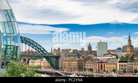 A view of the Gateshead Millennium Bridge on the River Tyne from Newcastle looking towards the Tyne Bridge. - Stock Photo
