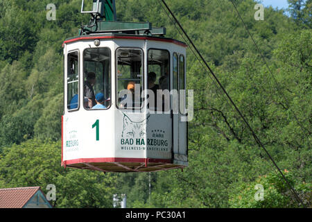Bad Harzburg, Lower-Saxony, Germany, July 27. 2018: Close-up of the cabin of the historic cable car with tourist on the way to the top of the Burgberg - Stock Photo
