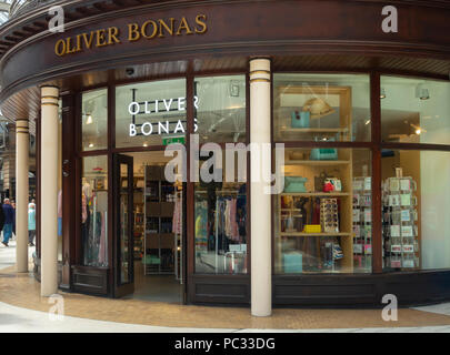 Exterior and entrance to the Oliver Bonas fashion and homeware shop on the concourse of Glasgow Central Station, Scotland. - Stock Photo