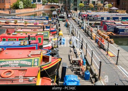 Moored narrowboats at Gas Street Basin on the Birmingham New Mainline Canal, Birmingham, England, UK - Stock Photo