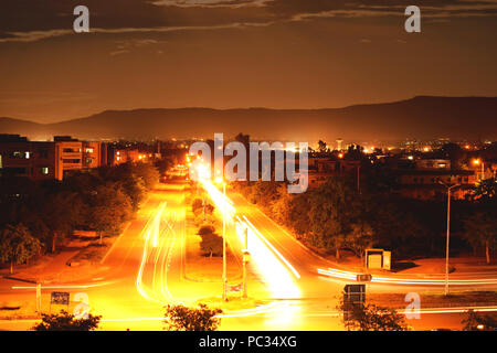 Light Trails Photography In the City. Lights Of Cars Captured with Cloudy Sky and Beautiful Mountains In the Background.Long Exposure & Shutter Speed - Stock Photo