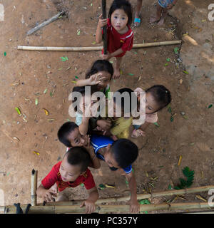 Children playing in Northern Laos village - Stock Photo
