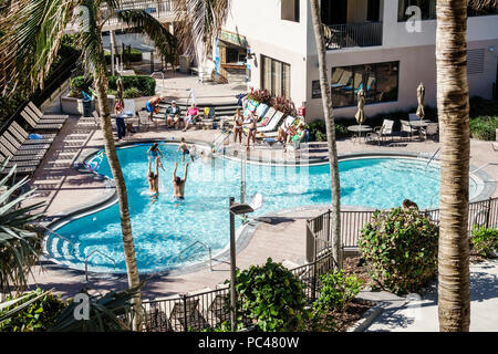 Florida Jensen Beach Hutchinson Island Starwood Vistana Beach Club swimming pool man woman girl boy family playing tossing child in air - Stock Photo