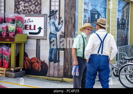 Sarasota Florida Pinecraft Pine Craft Yoder's Amish Village Amish Mennonite snowbird community Fresh Market deli exterior man suspenders hat beard pla - Stock Photo
