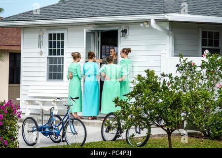 Sarasota Florida Pinecraft Pine Craft Amish Mennonite snowbird community house home door exterior teen girl woman young adults plain dress bonnet frie - Stock Photo