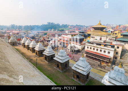 Hindu temple of Pashupatinath, seen from across the Bagmati river where traditional cremations take place, in Kathmandu, Nepal. - Stock Photo