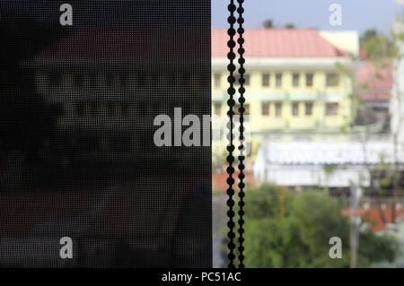 View of blinds on window. Close-uo.  Phu Quoc. Vietnam. | usage worldwide - Stock Photo