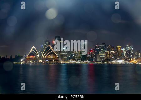 The Iconic Landscape of illuminated Sydney city and Opera House at night  Australia:30/03/18 - Stock Photo
