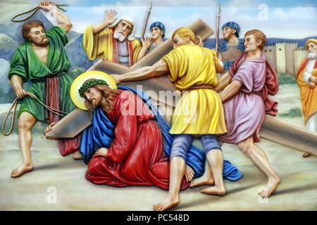 Our Lady of Fatima church.  Way of the cross.  Station 3. Jesus falls for the first time. Ho Chi Minh City.  Vietnam.   usage worldwide - Stock Photo
