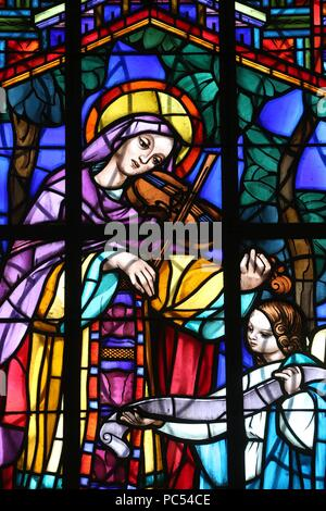 Dalat cathedral.  Stained glass window. Saint Cecilia  is the patroness of musicians. Dalat. Vietnam. | usage worldwide - Stock Photo