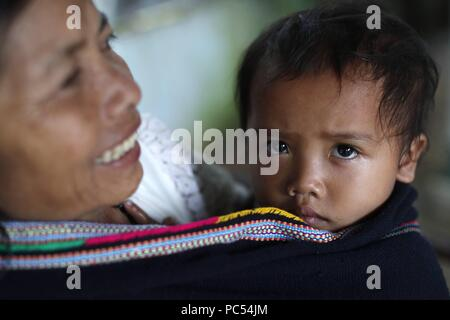 Bahnar (Ba Na) ethnic group. Mother with her son.  Kon Tum. Vietnam. | usage worldwide - Stock Photo