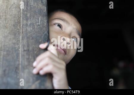 Bahnar (Ba Na) ethnic group.  Young boy. Portrait.  Kon Tum. Vietnam. | usage worldwide - Stock Photo