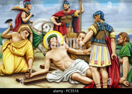 Our Lady of Fatima church.  Way of the cross.  Station 11. Jesus is nailed to the cross. Ho Chi Minh City.  Vietnam.   usage worldwide - Stock Photo