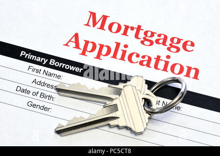 Real Estate Mortgage Application Loan Document With House Keys - Stock Photo